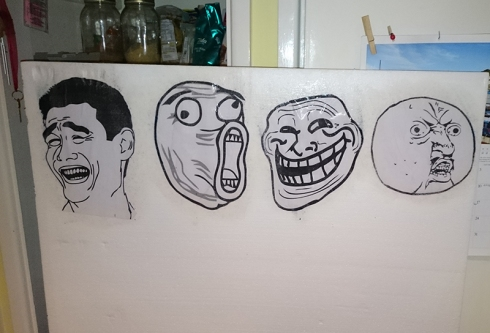 Photo of the basic meme face construction using polystyrene and laser prints